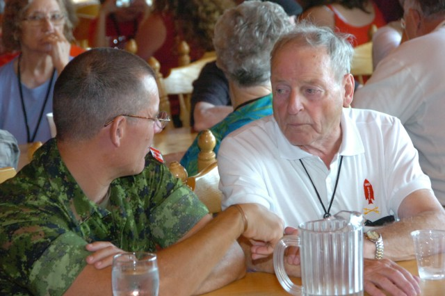 Vernon Doucette (right), a veteran of the First Special Service Force, speaks with a member of the Canadian army during a luncheon at Canadian Forces Base Stadacona Aug. 21 in Halifax, Canada during the Force's 63rd annual reunion. The FSSF was a World War II combined special operations force which U.S. Army Special Forces units today trace a portion of their lineage from.