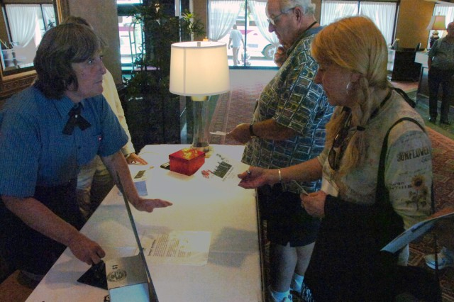 Attendees of the 63rd annual First Special Service Force reunion receive a cancellation stamp from the Canadian postal service Aug. 21 in Halifax, Canada.  The post office presented the collector's item to reunion attendees after a year of