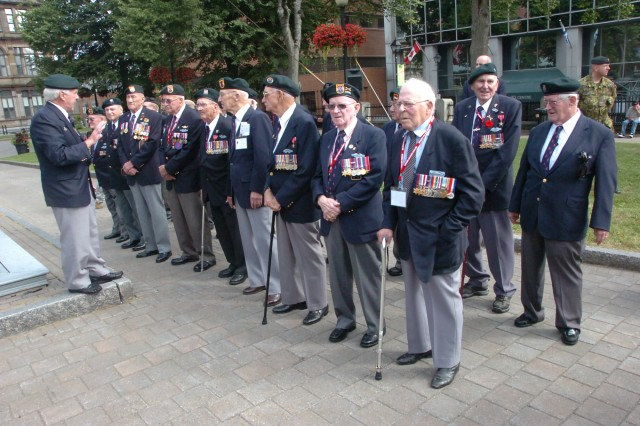 Veterans of the First Special Service Force stand in formation before the start of a ceremony held to honor the First Special Service Force Aug. 22 in Halifax, Canada during the Force's 63rd annual reunion. The FSSF was a World War II combined special operations force which U.S. Army Special Forces units today trace a portion of their lineage from.
