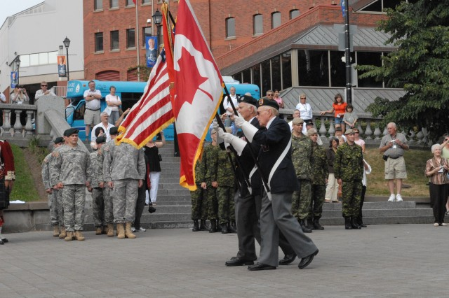 Members of First Special Service Force present the flags of Canada and the United States and the FSSF color during a ceremony held to honor the First Special Service Force Aug. 22 in Halifax, Canada during the Force's 63rd annual reunion.