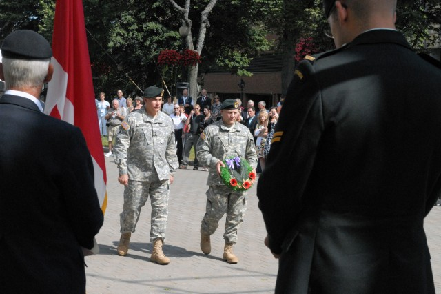 Major General Thomas Crsnko (left), commander of the John F. Kennedy Special Warfare Center and School, and Command Sgt. Major Charles M. Sekelsky lay a wreath during a ceremony held to honor the First Special Service Force Aug. 22 in Halifax, Canada during the Force's 63rd annual reunion.