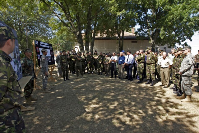 U.S. and Romanian servicemembers present information about on-going local humanitarian civic assistance missions to distinguished guests including U.S. Army Gen. Carter F. Ham and Romanian Land Forces Commander Maj. Gen. Dan Ghica-Radu Aug. 25 at Mihail Kogalniceanu Airfield, Romania.  As part of Joint Task Force-East, U.S.-Romanian HCA teams have been providing medical, dental and optometry screenings around the area for the past two months.  U.S. Navy Seabees have been here for over two years doing HCA construction projects including refurbishing local schools and other community projects.