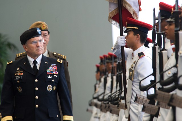 Chief of Staff of the Army Gen. George W. Casey Jr. inspects the Guard-of-Honor at the Ministry of Defense in Singapore Aug. 26, 2009.