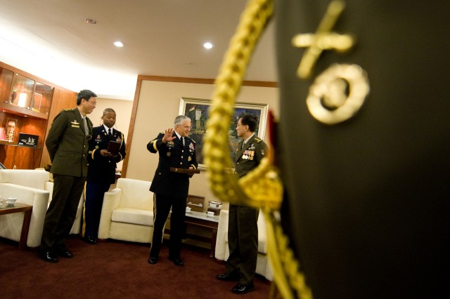 Singapore Chief of Defense Force Lt. Gen. Desmond Kuek talks with the Chief of Staff of the U.S. Army Gen. George W. Casey Jr.  after a meeting in Singapore, Aug. 26, 2009.