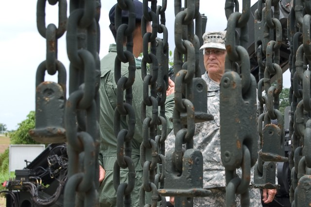 Chief of Staff of the Army Gen. George W. Casey Jr., is shown a mine clearing vehicle used by the Singaporean Army in Singapore, Aug. 26, 2009.
