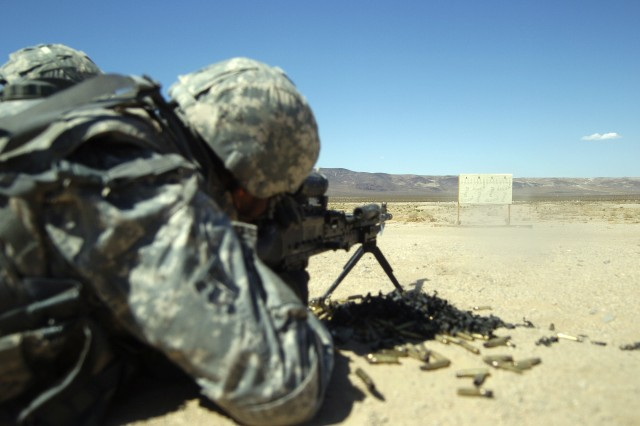 Pvt. Feliciano Castilliano, a Stinger gunner with India Battery, 1st Squadron, 11th Armored Cavalry Regiment,  and a native of Honolulu, fires at targets during an M240B machine gun qualification range at the National Training Center on Fort Irwin, Calif., Aug. 24. (Photo by Sgt. Giancarlo Casem, 11th ACR Public Affairs)