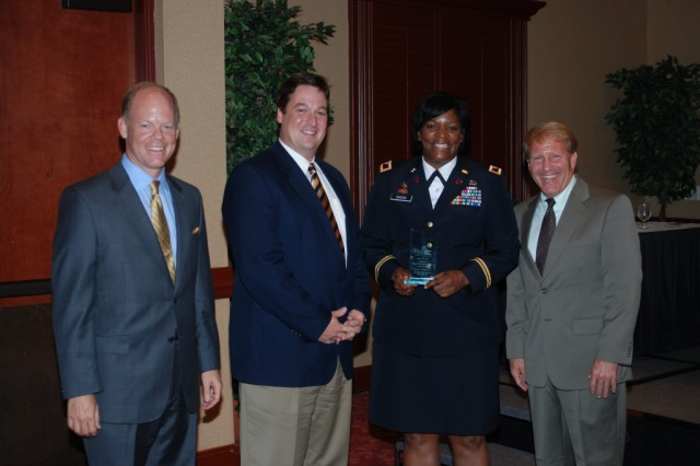 Col. Lillian Dixon, garrison commander, accepts the Palmetto Pillar Award for Green Technology Initiatives during a ceremony Aug. 20. Also pictured, from left, are Neil McLean, Dale Johnston and Lonnie Emard from the Columbia Information Technology Council. The award is presented to  companies or organizations for green technology-based projects.