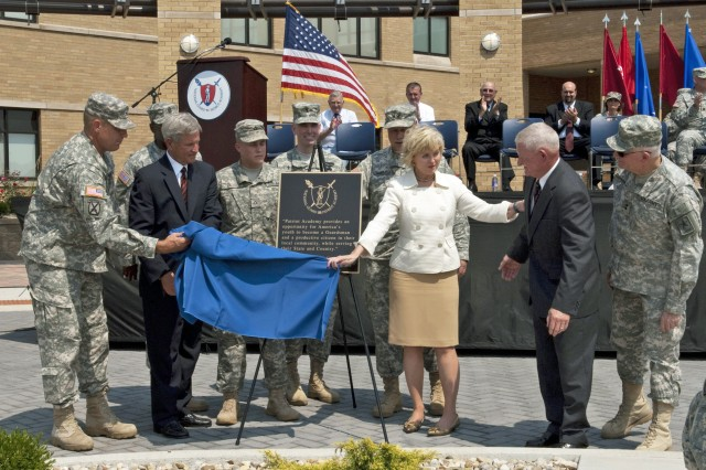 During the opening ceremony of the National Guard Patriot Academy, distinguished guests unveil a plaque bearing a quote from retired Lt. Gen. Clyde Vaughn at the Muscatatuck Urban Training Center near Butlerville, Ind. The guests and key speakers were: Col. Perry Sarver, Indiana Rep. Baron Hill, Command Sgt. Maj. Victor Angry, Pfc. Timothy Valley, Brig. Gen Bryan Hult, Indiana Lt. Gov. Becky Skillman, Maj. Gen. R. Martin Umbarger, retired Lt. Gen. Clyde Vaughn and Maj. Gen Raymond Carpenter.