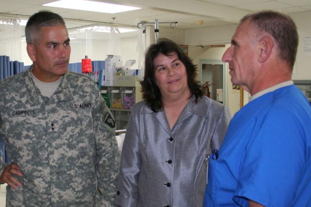 The Commanding General of Fort Campbell, KY, Maj. Gen. John F. Campbell and his wife Anne visited Blanchfield Army Community Hospital (BACH) Aug. 27.  They received a brief from BACH's hospital commander Col. John P. Cook and toured clinical areas.   Chief of the Emergency Center Lt. Col. Lawrence Leventhal explains the diversity of services offered in the emergency center to Maj. Gen. Campbell and his wife, Ann.