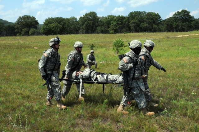 Soldiers from the 631st Maintenance Company carry a teammate on a litter to a helicopter landing zone during training at Fort McCoy, Wis. It was part of a training scenario during a mounted combat patrol where combat life-saving procedures are needed.