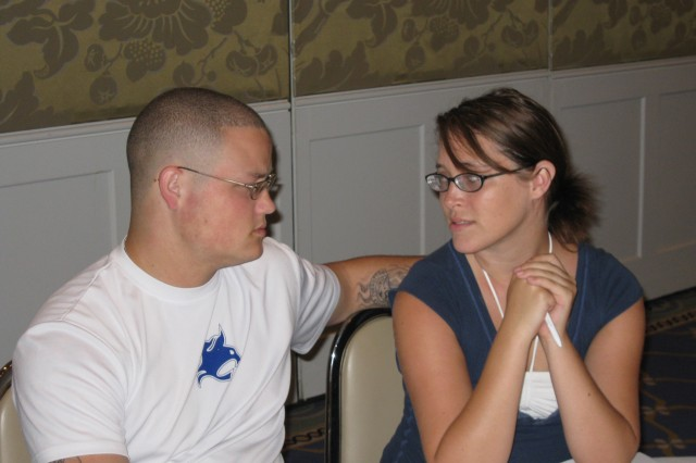 KO OLINA, Hawaii - Spc. Jonathan Happel and his wife, Cira, discuss family issues during the Strong Bonds marriage retreat at a resort, here, Aug. 22.