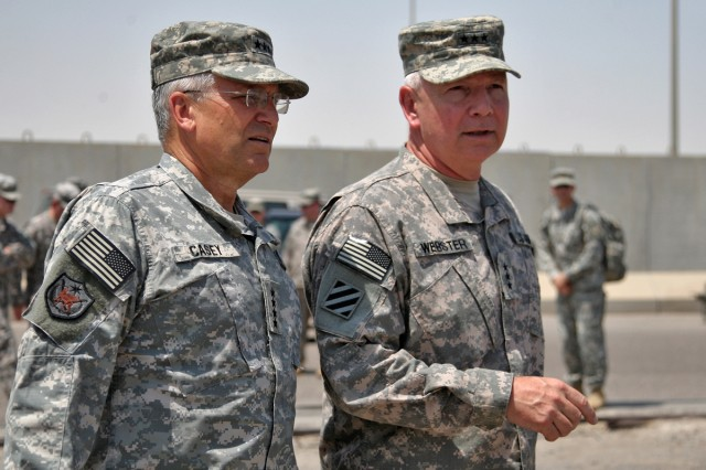 Gen. George W. Casey, Army Chief of Staff, meets with Lt. Gen. William G. Webster, commanding general, Third Army, during a site visit to the Sea Port of Debarkation, Kuwait, Aug. 28. Casey came to Kuwait to visit the troops at the bases here and receive a sense of preparedness to execute the responsible withdrawal from Iraq.