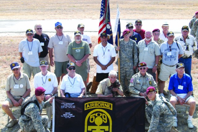 Veterans of the 509th Parachute Infantry Battalion, along with three Soldiers from 1st Bn (Abn), 509th Inf Reg, gather on Hall Drop Zone on Camp Bullis near San Antonio, Texas, during the 509th PIB annual reunion Aug. 22. The men seated in chairs on the front row are all World War II veterans.