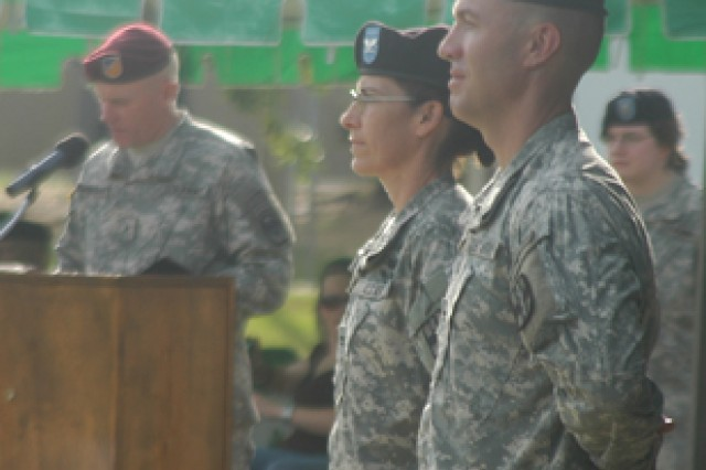 Col. John McGrath (right) outgoing commander, 115th Combat Support Hospital, and Col. Patricia Darnauer, incoming commander, stand at parade rest during a redeployment and change of command ceremony Aug. 21 at 1st Maneuver Enhancement Brigade Field.