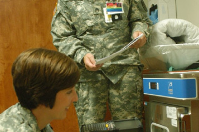 Staff Sgt. Amanda Christopher and Staff Sgt. Michelle Steiner conduct inventory at Bayne-Jones Army Community Hospital.