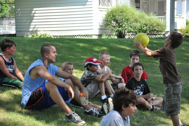 Watervliet Arsenal kids and staff regroup after a morning of soccer lessons provided by a professional sports clinic.  This was one of the many challenging events at this year's summer camp that kept kids safe and productive for July and August.  http://www.wva.army.mil/info.php