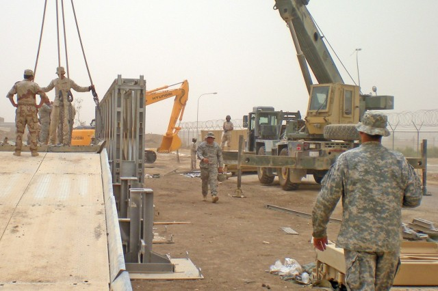 Iraqi engineers run through a bridge building excercise July 2009 in preparation  for a joint forces bridge build in September.