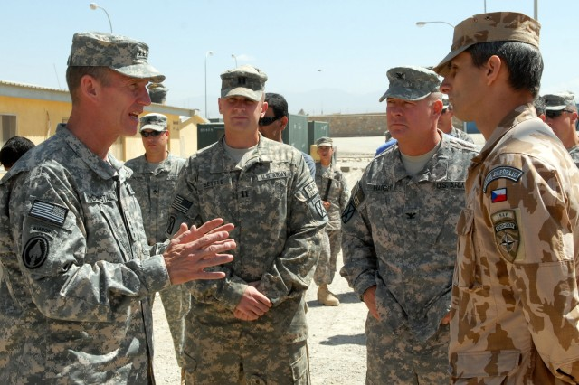 U.S. Army Gen. Stanley McChrystal, left, talks with a Czech soldier, right, during his visit to Forward Operating Base Shank, Afghanistan, Aug. 21, 2009. McChrystal is the commander of International Security Assistance Force and U.S. Forces Afghanistan. (DoD photo by Spc. Matthew Thompson, U.S. Army/Released)