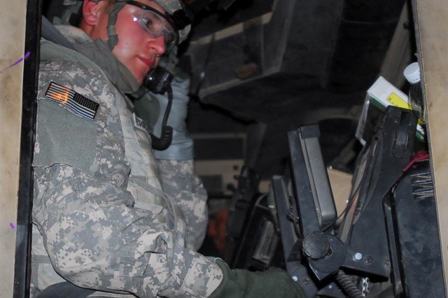 First Lt. Erickson, a native of Hunters, Wash., and the second platoon leader for the 1161st Transportation Company, 419th Combat Sustainment Support Battalion, 10th Sustainment Brigade, prepares his M915 tractor trailer for a convoy headed to Victory Base Complex, Iraq.