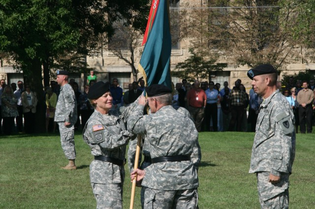 Maj. Gen. Robert M. Radin passes the ASC flag to Gen. Ann E. Dunwoody, formally relinquishing command of ASC.