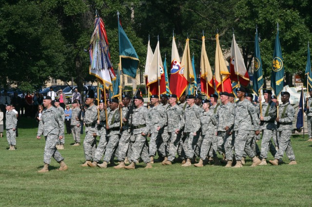 Soldiers from ASC march in formation during the change of command ceremony.
