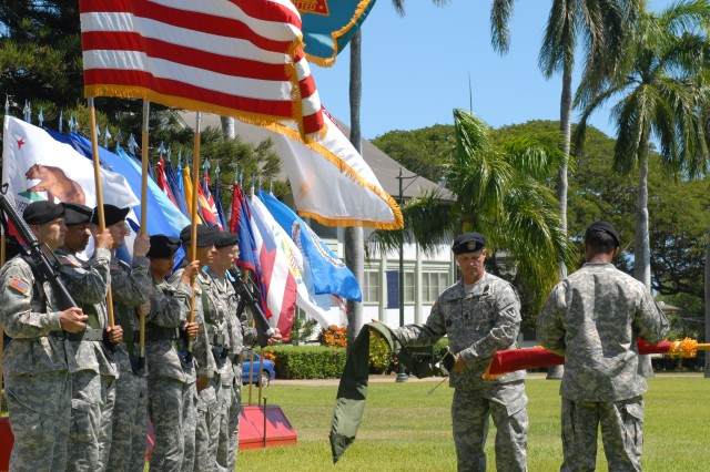 (FORT SHAFTER, Hawaii) - Command Sgt. Maj. John L. Murray, command sergeant major, U.S. Expeditionary Contracting Command, and Master Sgt. Darryl O. Bryant, 413th Contracting Support Brigade, uncase the unit colors during the 413th CSB activation ceremony on historic Palm Circle, Sept. 2.