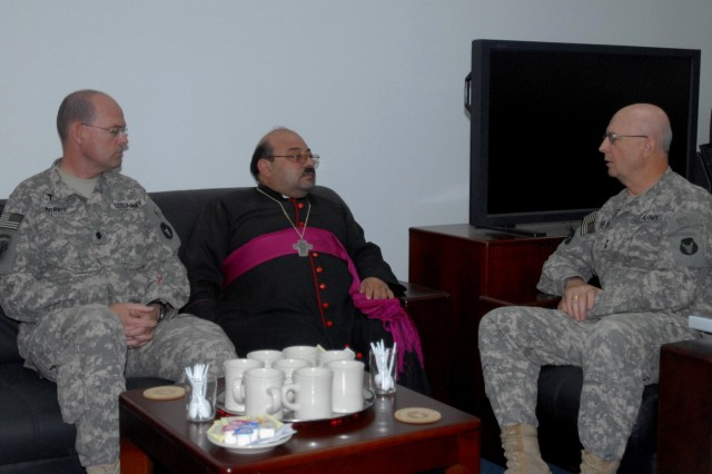 Bishop Imad Al Banna, officially recognized by the Roman Catholic Church as the acting Archbishop of Basra and a native of the city, meets with Chaplain (Lt. Col.) John Morris (left), command chaplain, 34th Red Bull Infantry Division, and Maj. Gen. Richard Nash (right), commanding general, Multi-National Division-South, at MND-S headquarters, July 13.