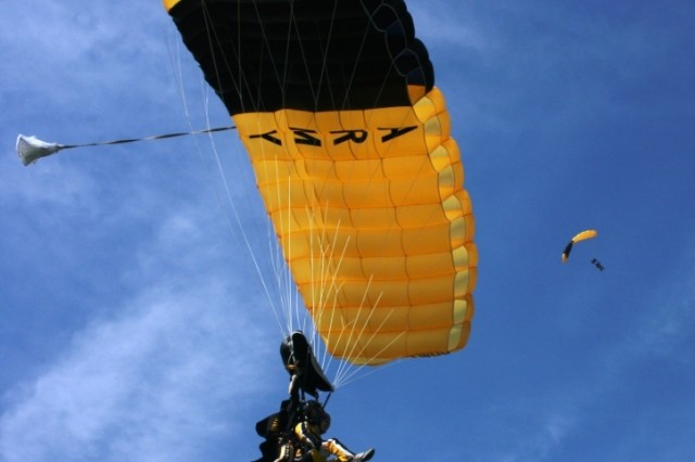 A view of a tandem jump with the U.S. Army Golden Knights Tandem Team, while another floats around in the breath-taking blue sky over Otawa, IL at Skydive Chicago, where the week-long tandem camp was held.