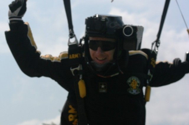 Sgt. First Class Eric Heinsheimer, U.S. Army Golden Knights Tandem Team Freefall Photographer, zooms in like lightning at about 50 MPH into Skydive Chicago. The Golden Knights gave each tandem jumper at their week-long tandem camp a personalized DVD of their experience, thanks to photographers like Heinsheimer who jump in first to catch their landing for the video.
