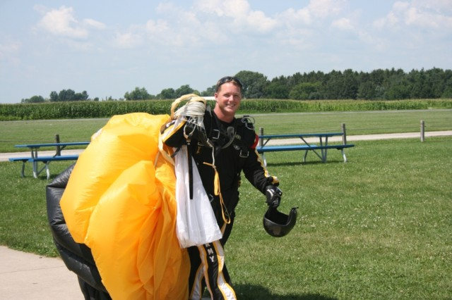Staff Sgt. Joe Jones, U.S. Army Golden Knights Tandem Team, exits the drop zone to get ready for another tandem jump at Skydive Chicago. Jones has over 4,000 jumps, with over 600 of those being tandems.