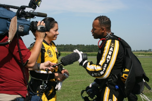 Stacey Baca, ABC 7 Chicago, interviews Sgt. 1st Class Mike Elliott , U.S. Army Golden Knights, after she just did a tandem jump with Elliott at Skydive Chicago, Ottawa, IL. Elliott, with over 10,000 jumps, serves as both the Tandem Team Leader and a Tandem Instructor.