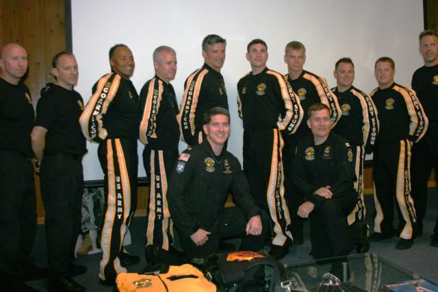 U.S. Army Golden Knights Tandem Team. From left to right: GK Sergeant Major, Sgt. Maj. Mike Eitinier; Sgt. 1st Class David Herwig; Team Leader, Sgt. 1st Class Mike Elliott; Sgt. 1st Class Eric Heinsheimer; Sgt. 1st Class Kurt Isenbarger; Sgt. Jared Zell; Sgt. Joe Abeln; Sgt. John Ewald; Staff Sgt. Joe Jones; GK Executive Officer, Lt. Col James Bean. Front: Pilots, Maj. Robert Degand and Capt. Craig Blackwood