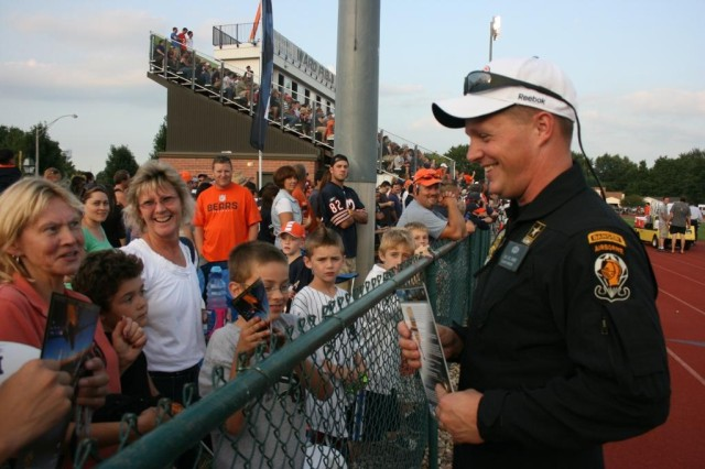 Staff Sgt. Joe Jones talks to some of the thousands of kids in the stands at a Chicago Bears game.