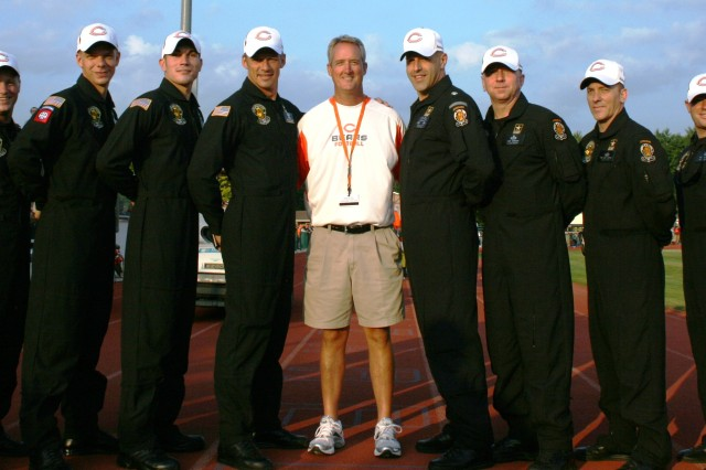 Chicago Bears Owner, Brian McCaskey, poses with the U.S. Army Golden Knights Tandem Team after they jumped into a pre-season game for him in Bourbonnais, IL.