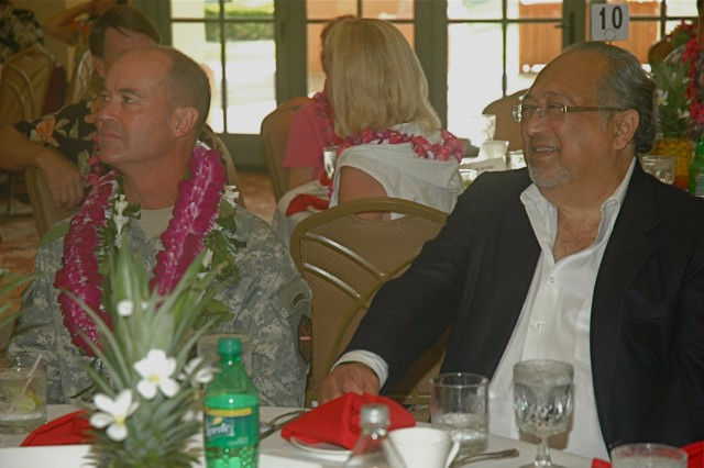 SCHOFIELD BARRACKS, Hawaii - Sharing one of the tables at the Native Hawaiian Lecture Series, held Aug. 29 at Nehelani, Schofield Barracks, are Col. Matthew Margotta, Commander, USAG-HI, and event guest speaker Dr. Mitchell Eli, a teacher of the ancient Hawaiian martial art, lua.
