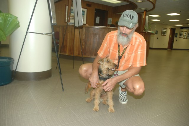 TRIPLER ARMY MEDICAL CENTER, Hawaii - Volunteer Mac McDaniel takes his therapy dog Baxter on a visit to TAMC.
