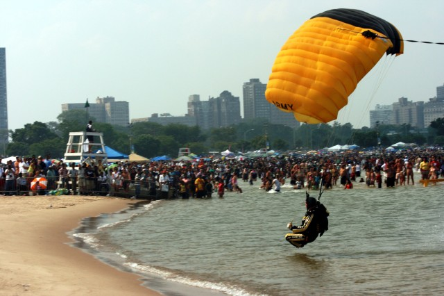 Sgt Maj. Michael Eitniear thrills the crowd along North Avenue Beach as he Pond Swoops along the 2009 Chicago Air & Water show's lakefront, as some of the million spectators get a close up look of his skills.