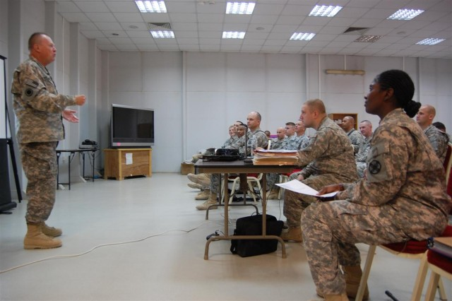 Lt. Col. William Cook, the Joint Base Balad Reserve affairs officer in charge, briefs officers of the 49th Transportation Battalion, 13th Sustainment Command (Expeditionary), during an officers' professional development conference Aug. 28 at Joint Base Balad, Iraq.