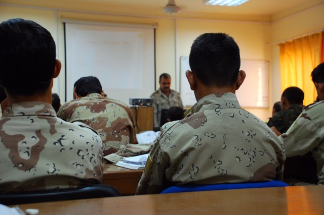 Students at the Iraqi Army Bomb Disposal School sit in class to learn technical aspects of disarming improvised explosive devises, Aug. 26, in Besmaya, Iraq.