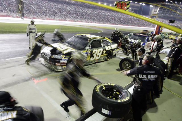 The Army team changes tires on the #39 Chevy Impala in the pit Sunday night during the Pep Boy 500 in Atlanta where Ryan Newman finished ninth.