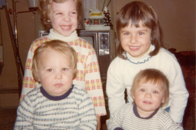 A family photo of Sgt. 1st Class Jared C. Monti, lower left, with his sister and cousins.