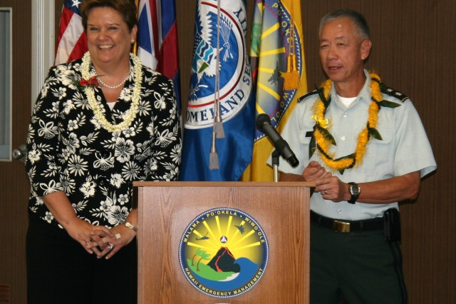 """U.S. Department of Homeland Security Federal Emergency Management Agency Regional Administrator Nancy Ward and Hawaii Civil Defense Director Major General Robert G. F. Lee stand at the podium in the Hawaii Civil Defense Media Center following the signing of a Memorandum of Understanding (MOU) that formally adopts both Hawaii's All-Hazards Concept Plan (CONPLAN) and Catastrophic Hurricane Operations Plan (OPLAN). The event took place Wednesday, Sep. 2nd in front of reporters, first responders, emergency managers and catastrophic planners at the local, State and Federal level. """"These documents now form a foundation of additional plans that will guide federal and state agencies in responding to a host of challenges,"""" said Ward. """"The completion of these documents was possible only through the leadership and presence these organizations provided."""" The development and testing of the CONPLAN and OPLAN also represents an """"emergency response first"""" following Hawaii's agreement to be the first state in the nation to engage in a joint planning exercise that fully employs the FEMA Integrated Planning System (IPS), which is scheduled to become a national template for joint federal/state and local disaster planning. (Official JTF-HD Photo by Mr. Darrell Ames)"""