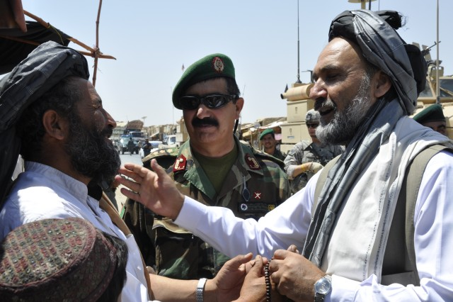 Gov. Mohammad Ashraf Naseri meets and greets locals during his Aug. 24 trip to Sha Joy district to discuss issues and concerns with village elders. The Provincial Reconstruction Team-Zabul provided transportation and security. PRT-Zabul -- a civil and military organization that brings reconstruction, development, governance and security to the province -- works side by side with the provincial government to reconnect it with the people.