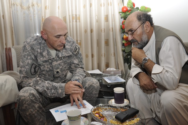 Air Force Lt. Col. Andy Veres, the Provincial Reconstruction Team-Zabul commander from Melbourne, Fla., and Gov. Mohammad Ashraf Naseri discuss future plans on improving the province.