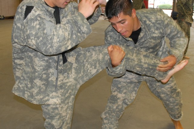 Sgt. 1st Class Rodolfo Ruiz, left, 1st Battalion, 34th Infantry Regiment, and Sgt. John Duran, 2nd Battalion, 13th Infantry Regiment, practice combatives techniques during a training session Sept. 1. Ruiz and Duran are members of the Fort Jackson combatives team.