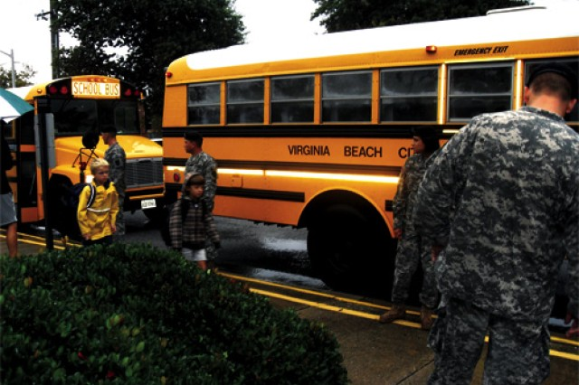 Soldiers from the 11th Trans. Bn. greet students upon their arrival at John B. Dey Elementary School in Virginia Beach.