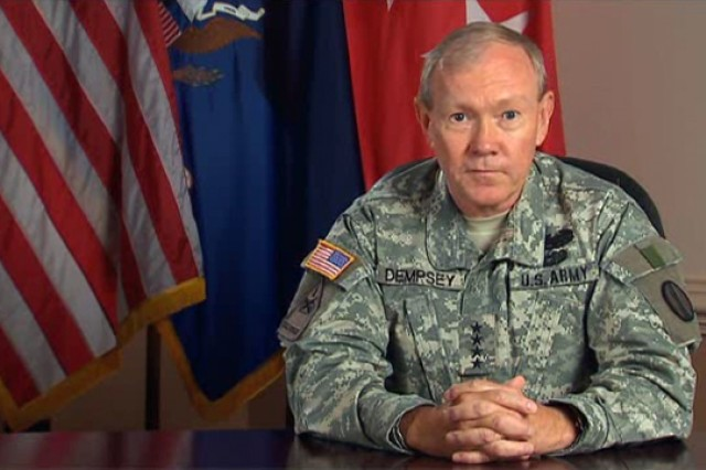 Gen. Martin Dempsey, commanding general of the U.S. Army Training and Doctrine Command, and Col. Karen O'Brien, TRADOC surgeon, discuss tips to prevent the spread of the flu and H1N1 vaccine procedures.