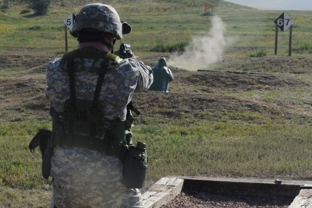 Capt. Mark Sommer, Anti-terrorism/ Force Protection Officer, 100th MDB, shoots down a pop-up target during the brigade's semi-annual 9 millimeter range at Fort Carson, Sept. 3. The range consists of five tables in which Soldiers have to hit sixteen out of thirty targets in order to qualify.