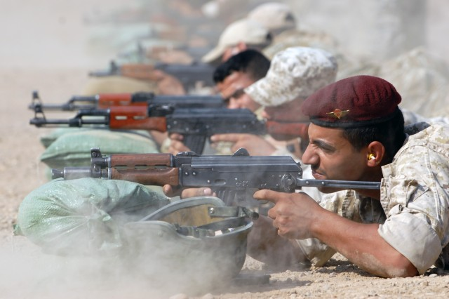 BAGHDAD - Dust kicks up as Iraqi Army Soldiers of the 6th IA Division fire at 25 meter zero targets during a range at Joint Security Station Salaam, here, Sept. 7. The Soldiers are instructed to make methodical shots to ensure the same sight picture.