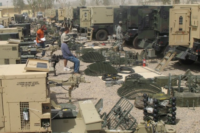 Soldiers from the 51st Signal Battalion inventory equipment at Balad, Iraq.